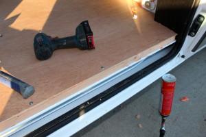 edges of plywood van floor