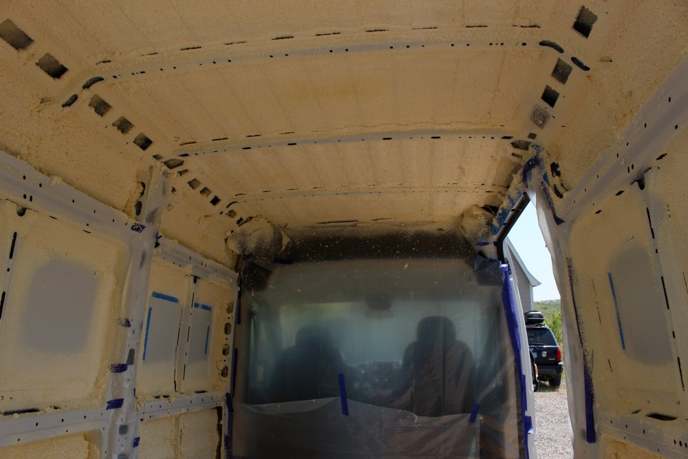 spray foaming insulation for a camper van