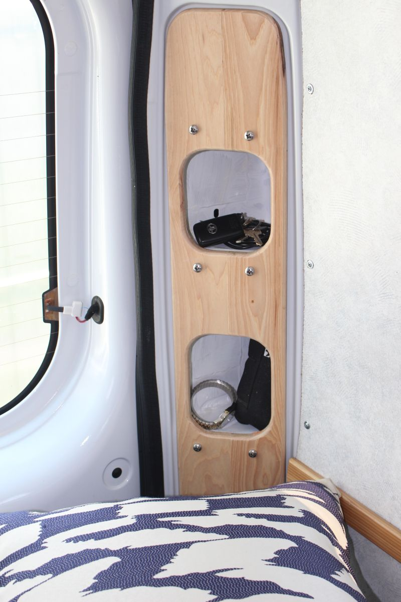 Cubby hole storage at head of beds.