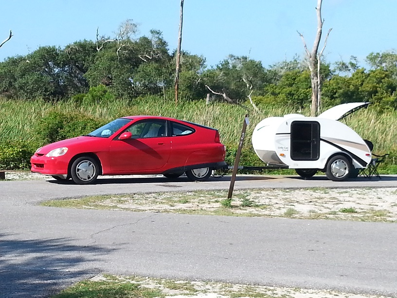 "Honda Insight pulling ""Little Guy"" teardrop trailer."